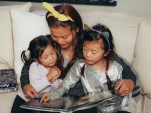 a mother reads to her kids